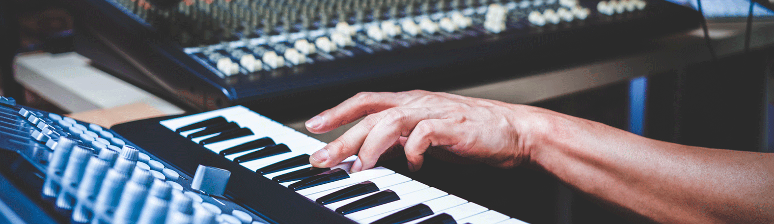Composer Hand Playing Midi Keyboard for Recording